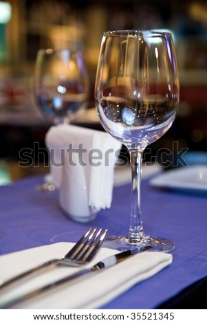 wineglass on served table in restaurant