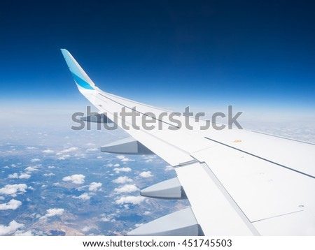 Wing of a airplane with winglet over the clouds