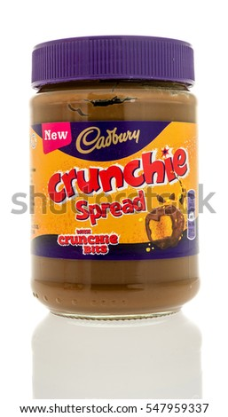 Winneconne, WI - 3 January 2017:  Jar of Cadbury crunchie spread on an isolated background.