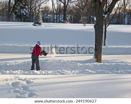 WINNETKA, IL - FEBRUARY 2, 2015: Man shovels snow in the northern suburbs after fifth-heaviest snowfall ever in the Chicago area.