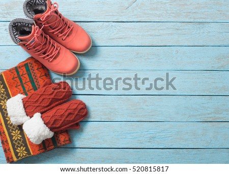 winter clothes and shoes on a wooden background