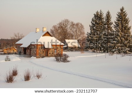 Winter evening in the snow-covered village