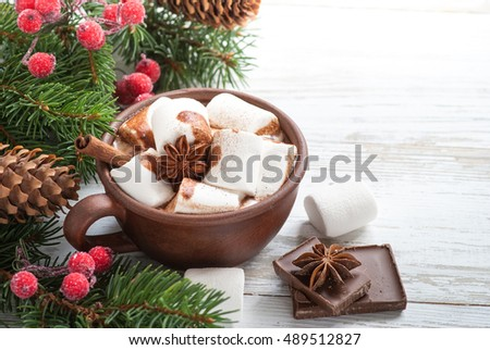 Winter hot drink. Christmas hot chocolate with marshmallow and spices.