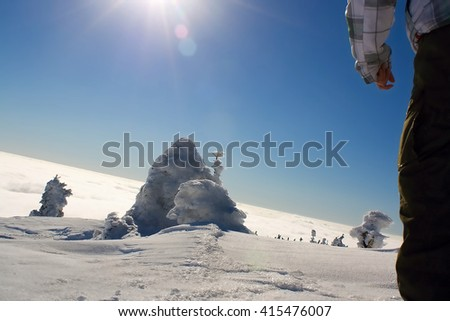 Winter landscape, snowy mountains, inversion, way behind the sun