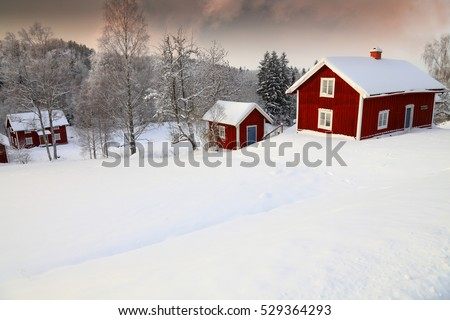 winter landscape with old rural cottages in Sweden