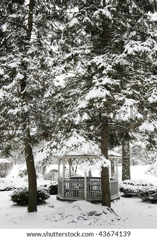 winter landscape with snow covered trees over gazebo
