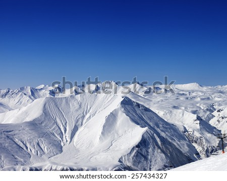 Winter mountains and blue clear sky at nice day. Caucasus Mountains, Georgia. Ski resort Gudauri.