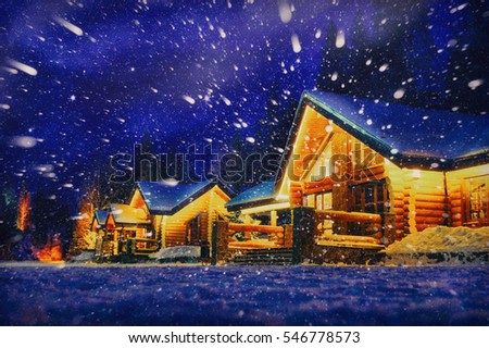 Winter scene of a cabin in distance at night with snow