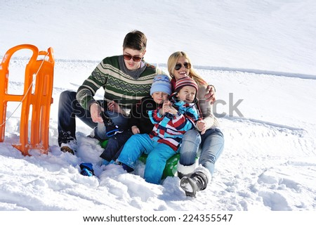 Winter season. Happy family having fun on fresh snow on vacation