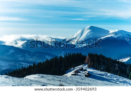Winter snow covered mountain peaks and trees in Ukrainian Carpathians, Europe. Great place for winter hiking, trekking, ski. Cold toning