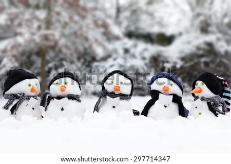 Winter snowman scene with snow and trees