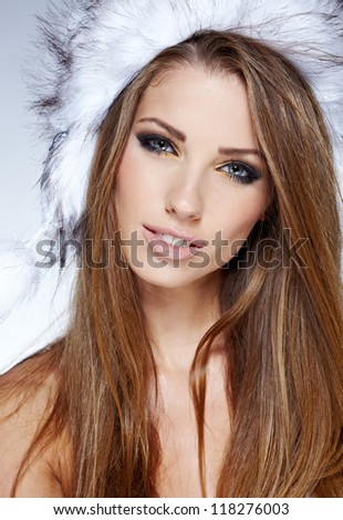 Winter studio portrait of a beautiful women