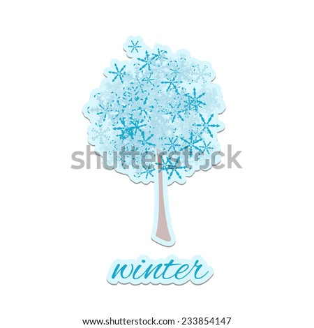 Winter tree on cut piece of paper.