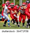 WOLFSBERG, AUSTRIA - AUGUST 20 American Football B-EC: RB Dan Kaltoft Boehm (#2, Denmark) and his team beat the Czech Republic 34:0 on August 20, 2009 in Wolfsberg, Austria. - stock photo