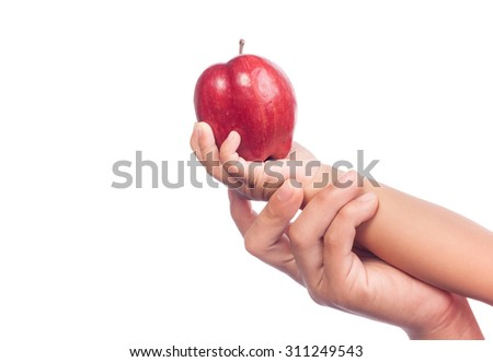 Woman and baby hand holding red apple. Isolated on a white background.
