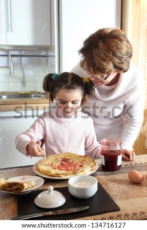 Woman and child making pancakes
