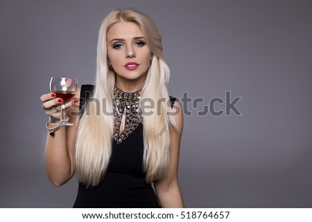 Woman and Happy 2017.New year's eve concept - beautiful woman in evening dress with cocktail show clock
