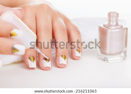 Woman applying nail polish for perfect manicure