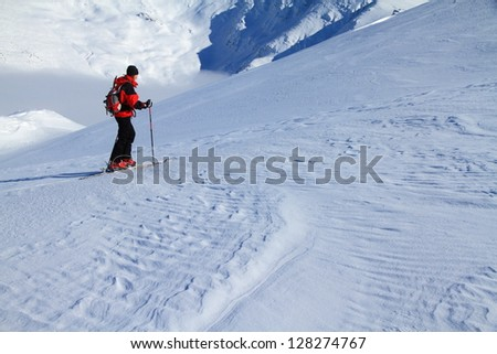 Woman ascending during ski touring in Tarcu mountains, Romania