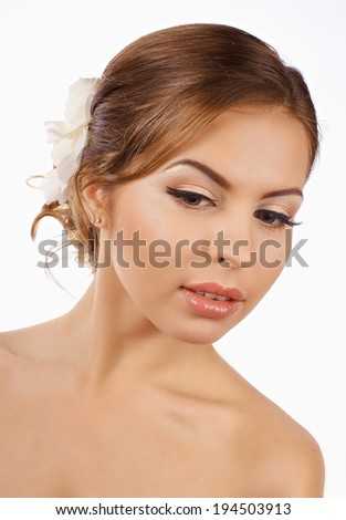 Woman beautiful face with nude makeup