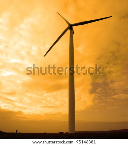 woman beside a windmill on lush irish countryside landscape in glenough county tipperary ireland