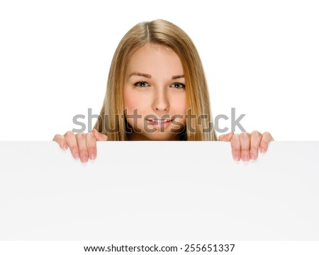 woman billboard. Young beautiful woman showing blank white placard.