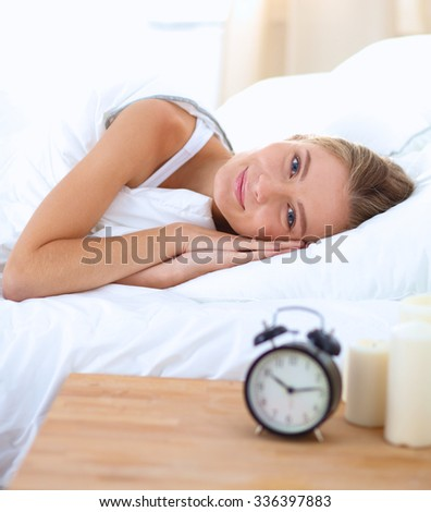 Woman can not sleep.Clock on the desk