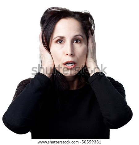 Woman covers her ears after a loud noise