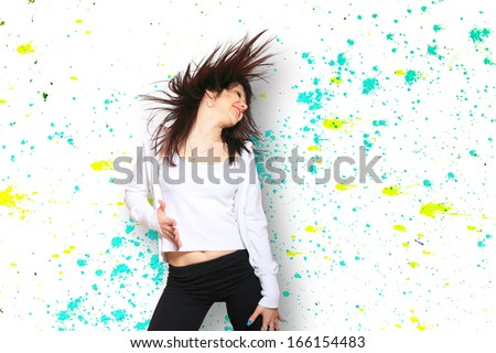 Woman dancing over graffiti background