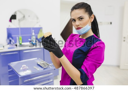 Woman dentist show with denture