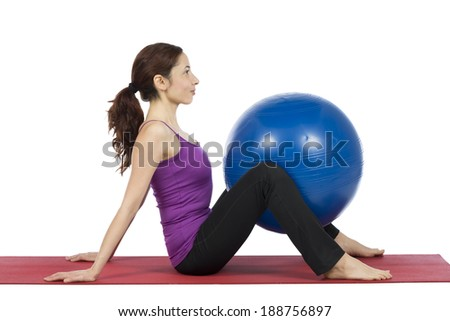Woman doing exercises with a pilates ball.