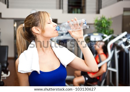 Portrait woman gym drinking water stock photo 103069661 shutterstock woman drinking water in the gym sciox Gallery