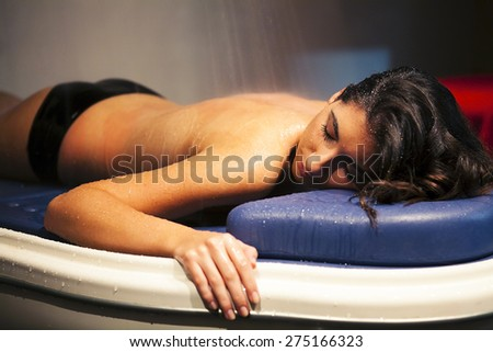 Woman during spa treatment with water.