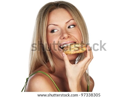 woman eating a cake on a white background