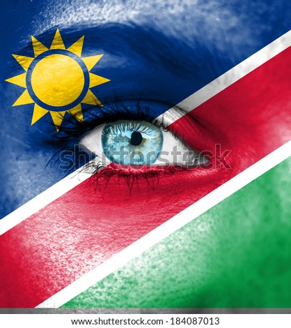 Woman face painted with flag of Namibia