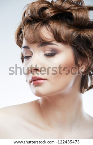 Woman face with curly  hair on white background isolated close up portrait. Beauty style photo with young model. Closed eyes with make up.
