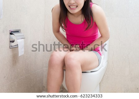 Woman urine urgency bathroom stock photo 623234255 - How to use the bathroom when constipated ...
