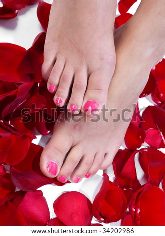 woman feet on roses