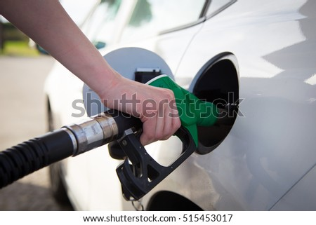 Woman filling the fuel in the gas station