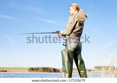 woman fishing at a pond