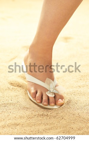 Woman foot on beach