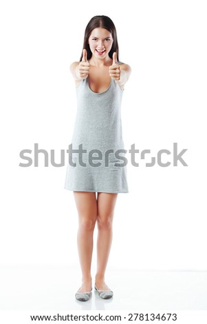woman full body portrait thumb up show. white background .