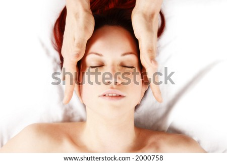 woman getting a head massage by therapist