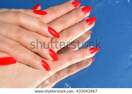 Woman hand and pure water