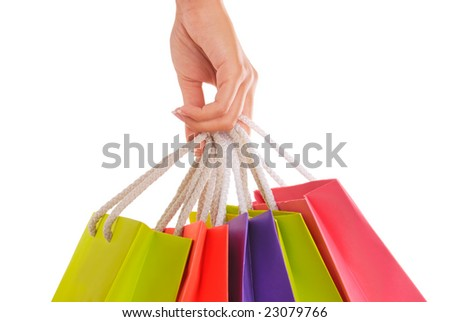Woman hand carrying a bunch of shopping bags, isolated on white.