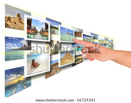Woman hand reaching images on the screen