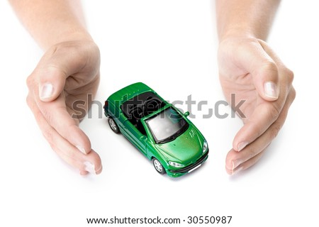 woman hands holding green car isolated on white background