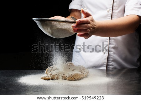 Woman hands kneading dough.