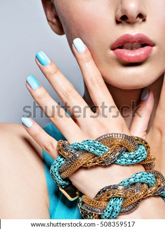woman hands nails manicure fashion blue jewelry. Female hands with blue fingernails