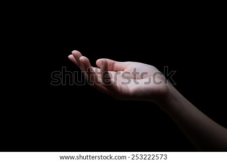 woman hands palms up over black background